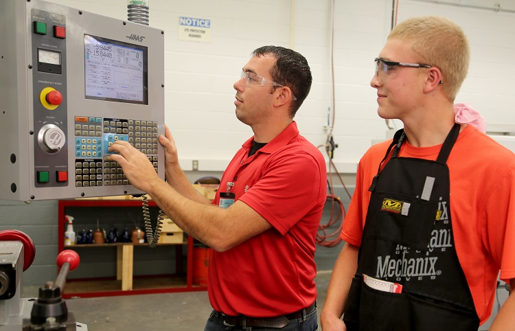 Machining instructor and student