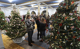 Those attending the annual tree-lighting ceremony December 2, 2010, looked at decorated trees in Blue Room.