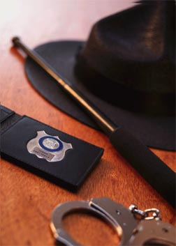 Act 120 municipal police academy badge, handcuffs, nightstick, and hat