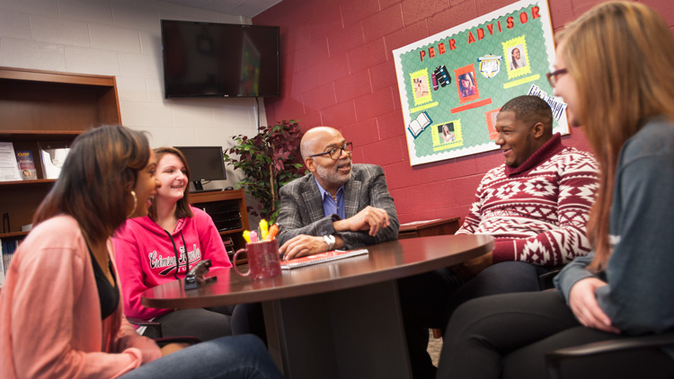 Students talk with Professor Melvin Jenkins