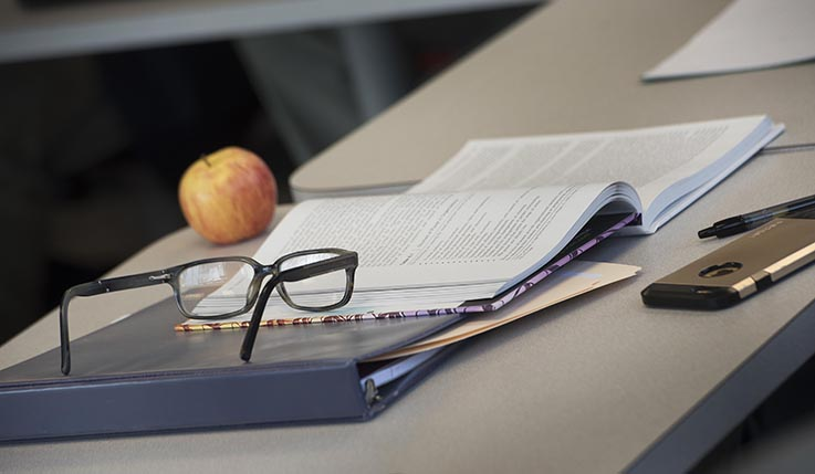 Studying materials on a classroom desk