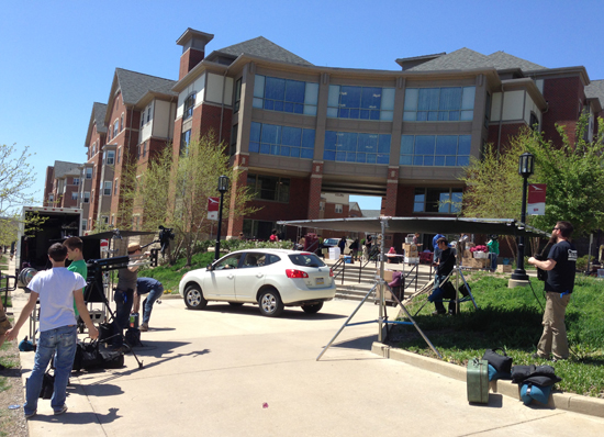 The first major scene of the video is move-in day, which was recreated in front of Delaney Hall
