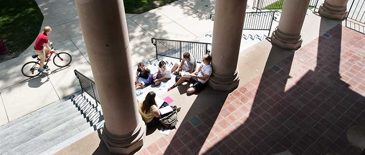 Students hanging out on the steps of Waller Hall.