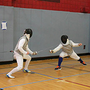 Joe Yaure in a fencing duel.