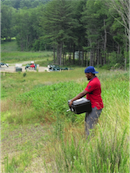 IUP graduate student collecting an air sample near the compressor station at Beaver Run Reservoir