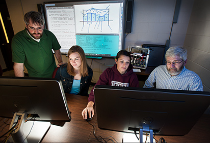 Students and a professor in the High Performance Computing Lab