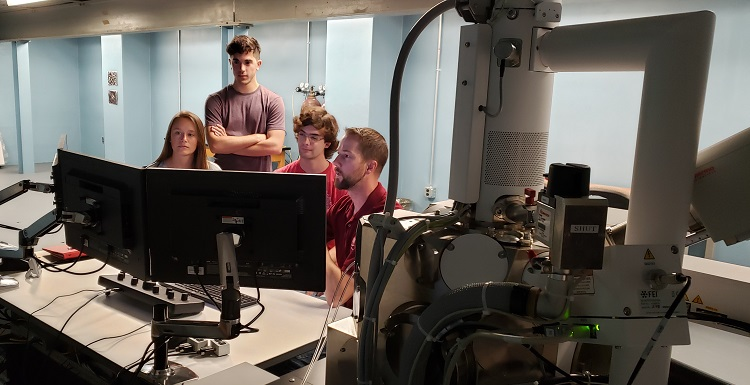Students working with the ThermoScientific PrismaE Scanning Electron Microscope