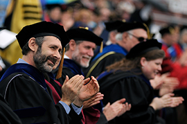 Alumni clapping during commencement