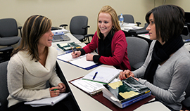 Three graduate students in a meeting