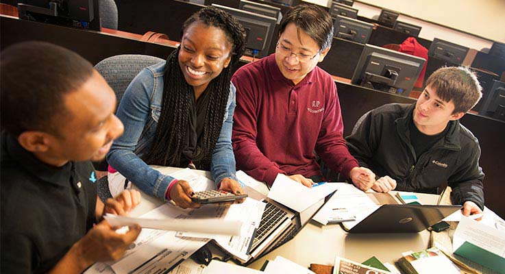 Four accounting students work on a tax project